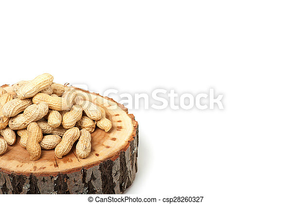 Pile of unshelled peanuts, isolated on white background - csp28260327