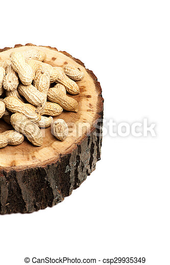 Pile of unshelled peanuts, isolated on white background - csp29935349