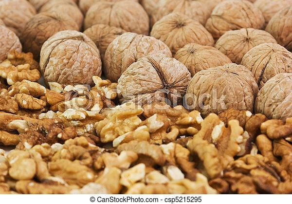 pile of walnuts broken - csp5215295