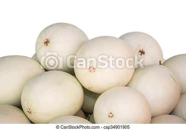 Pile of white cantaloupe isolated on white background - csp34901905
