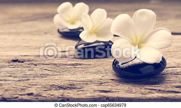 Pile Of Zen Stones And Frangipani Flower Isolated On White