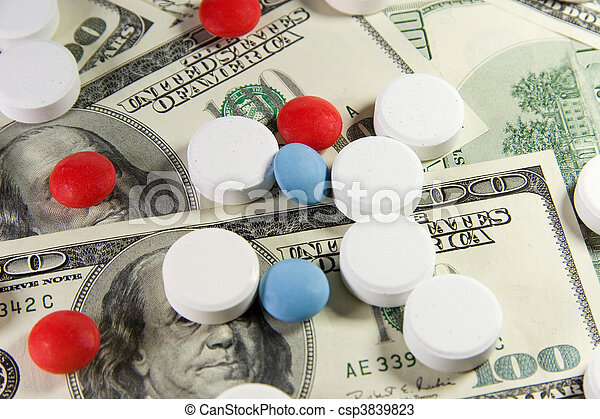 Pills on a bunch of US dollars - csp3839823
