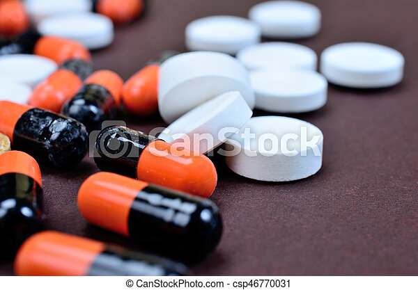 pills on table - csp46770031