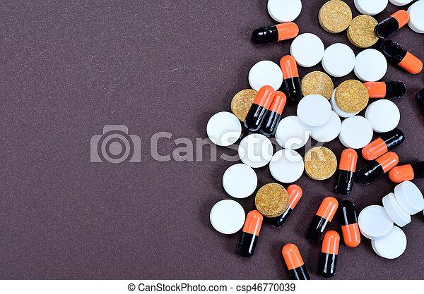 pills on table - csp46770039
