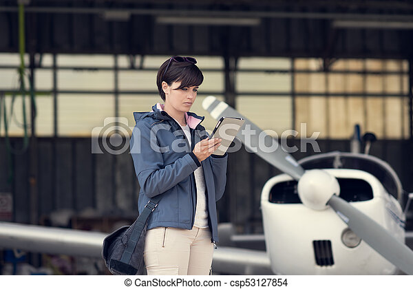Pilot using aviation apps - csp53127854