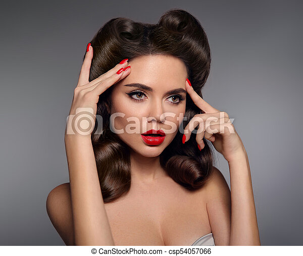 Pin Up Girl With Red Lips Makeup Manicure Nails And Retro Curls