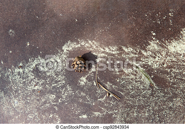 Pine cone and yellow pollen grains on a brown background. Allergy, hay fever concept. - csp92843934