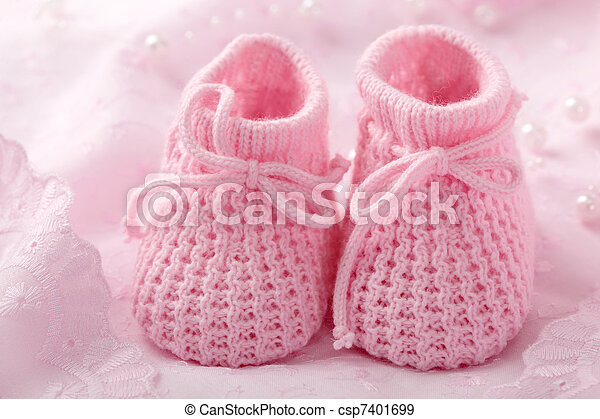 c0266e0b7 Pink baby booties on pink background.