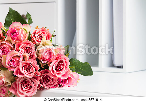 Pink blooming roses on wood - csp45571914
