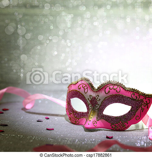 Pink carnival mask with glittering background - csp17882861