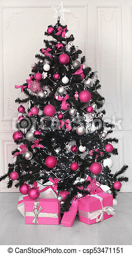 Pink Christmas Tree With Ball Gifts Decoration Before White Wall In Holiday Room Interior Home