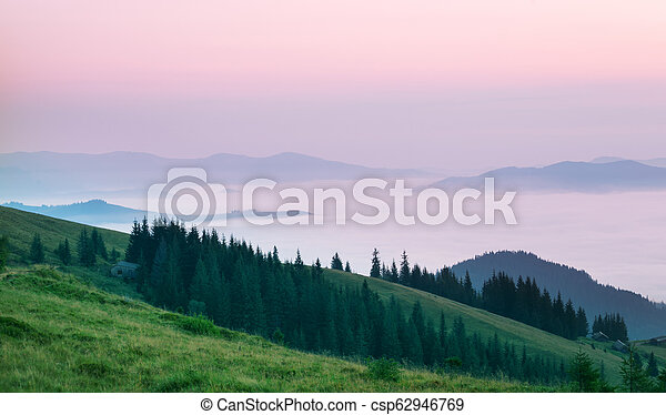 Pink clouds over the mountains in morning - csp62946769