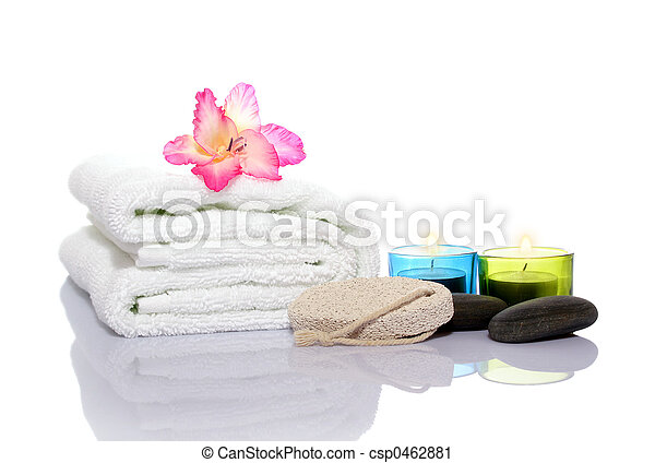 Pink gladiola, towel, candles and river stones - csp0462881