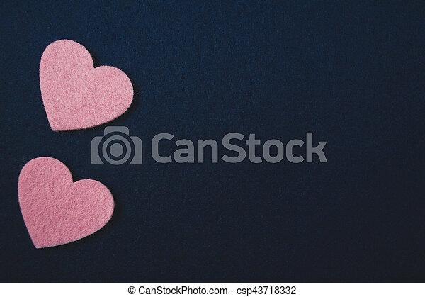 pink hearts on dark blue felt background. valentine's day - csp43718332