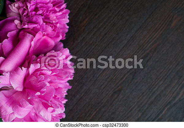 pink peonies on rustic wooden background - csp32473300