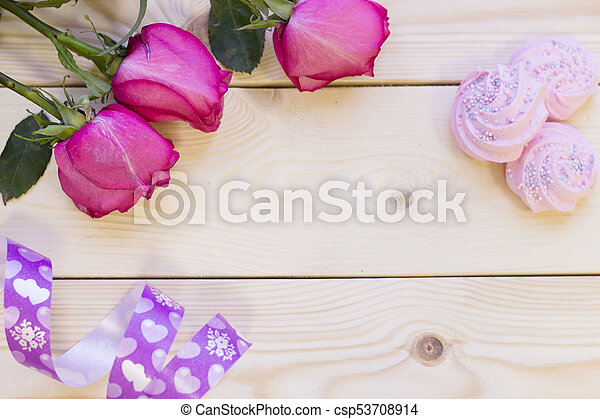 Pink roses on wooden background - csp53708914