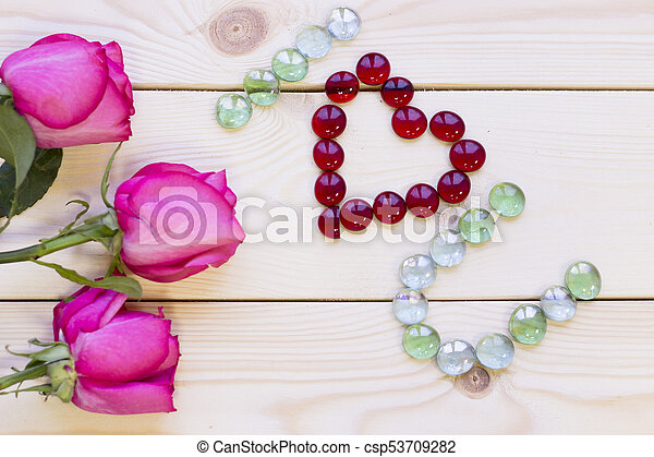 Pink roses on wooden background - csp53709282