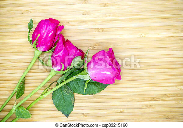 Pink roses on wooden background, Valentines day background - csp33215160