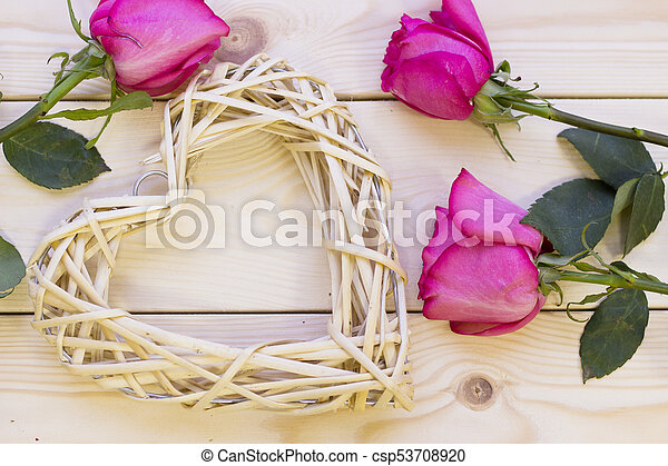 Pink roses on wooden background - csp53708920