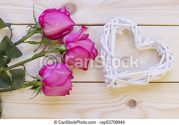 Pink roses on wooden background - csp53708944