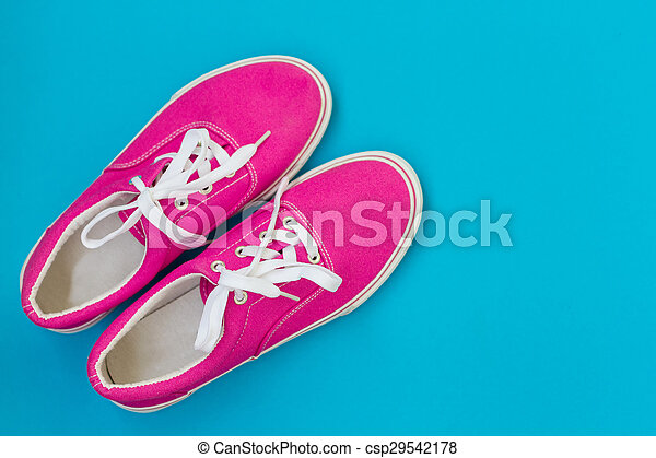 Pink sneakers with laces on a blue - csp29542178