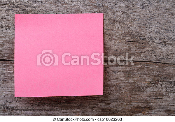 pink sticker on an old wooden table - csp18623263