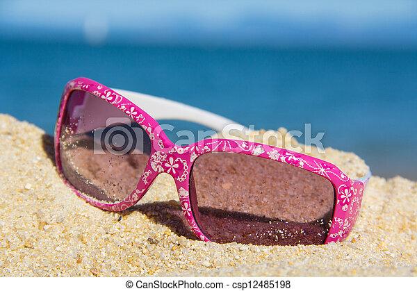 pink suglasses near the sea - csp12485198