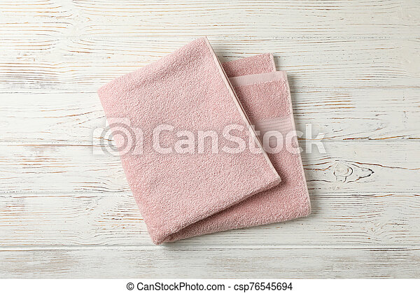 Pink towel on white wooden background, top view - csp76545694