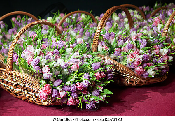 Pink tulips in a basket closeup - csp45573120
