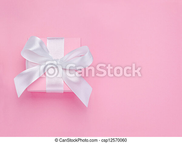 Pink Valentines Day gift box tied white satin ribbon bow - csp12570060