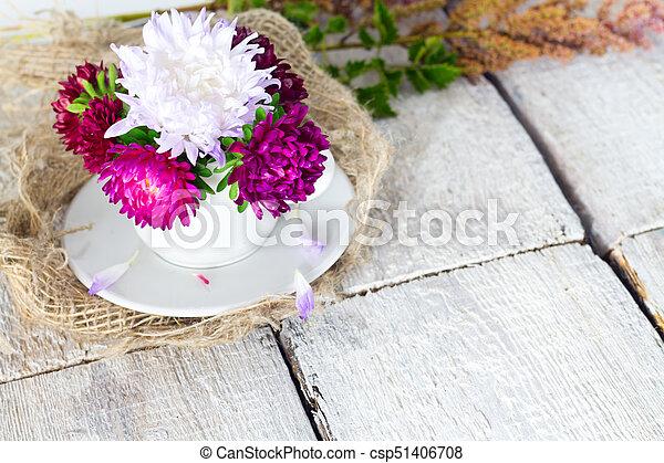 Pink vintage flower on white wooden background. - csp51406708