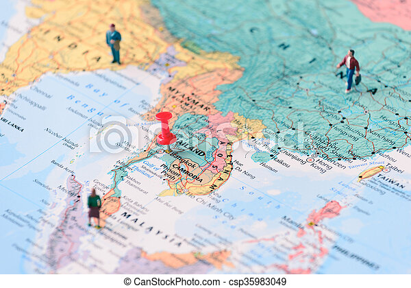 Pinned on map of bangkok in thailand and miniature travelers.