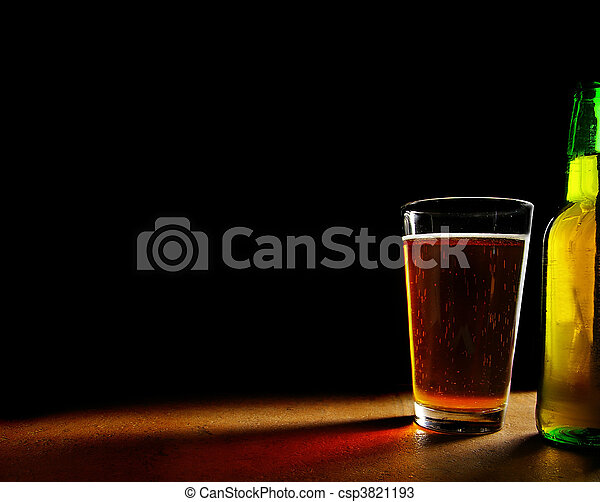 pint glass of beer and bottle, on black background - csp3821193