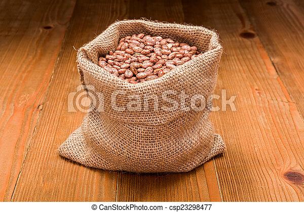 Pinto beans in burlap bag - csp23298477