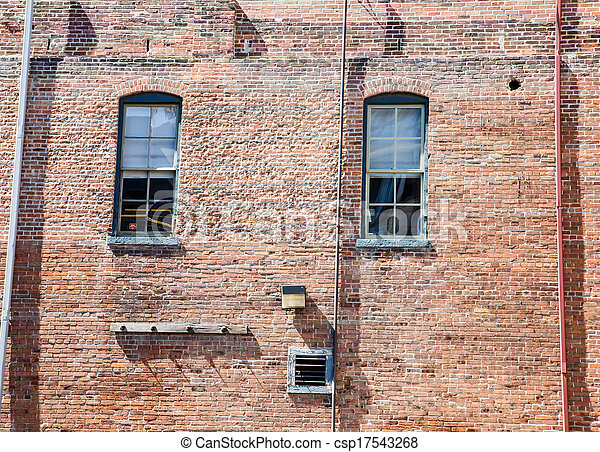 Pipes and Windwos on Old Brick Wall - csp17543268