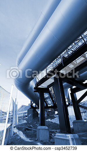 Pipes, bolts, valves against blue sky in blue tones - csp3452739