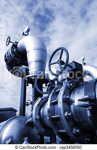 Pipes, bolts, valves against blue sky in blue tones - csp3456050