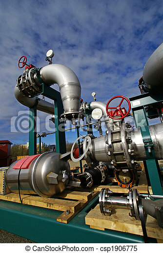 Pipes, bolts, valves against blue sky - csp1906775