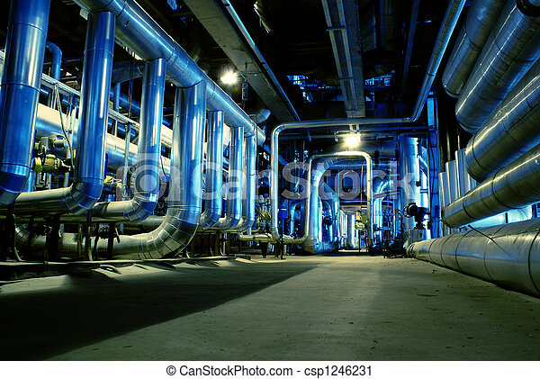 Pipes, tubes, machinery and steam turbine at a power plant - csp1246231