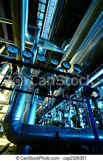 Pipes, tubes, machinery and steam turbine at a power plant - csp2326351