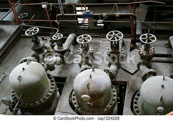 Pipes, tubes, machinery and steam turbine at a power plant - csp1224228