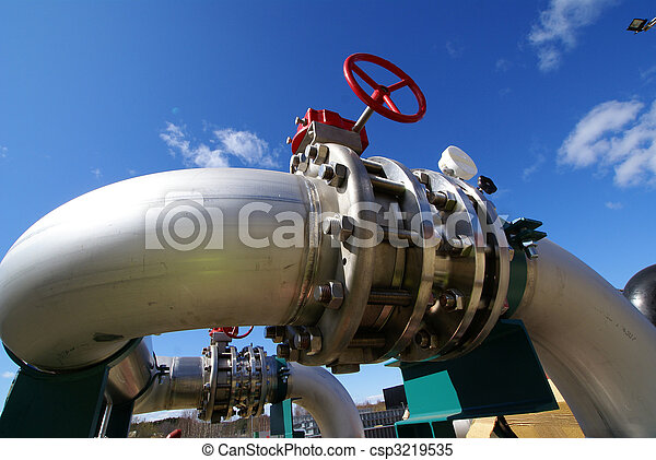 Pipes, tubes, machinery and steam turbine at a power plant - csp3219535
