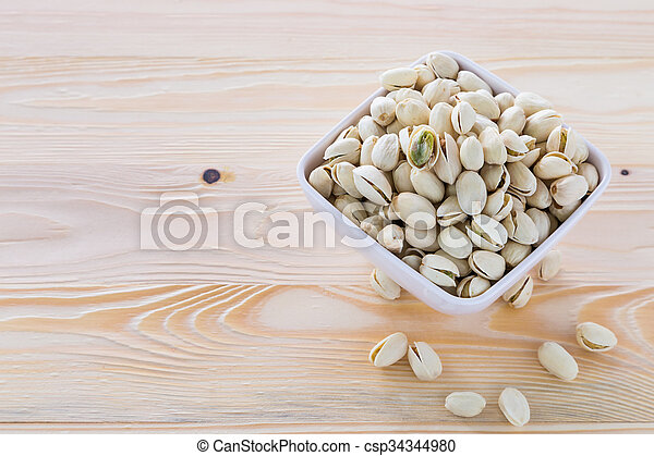 Pistachio nuts in a bowl - csp34344980