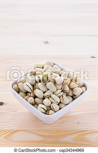 Pistachio nuts in a bowl - csp34344969