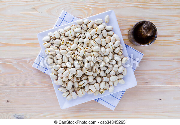 Pistachio nuts in a bowl - csp34345265