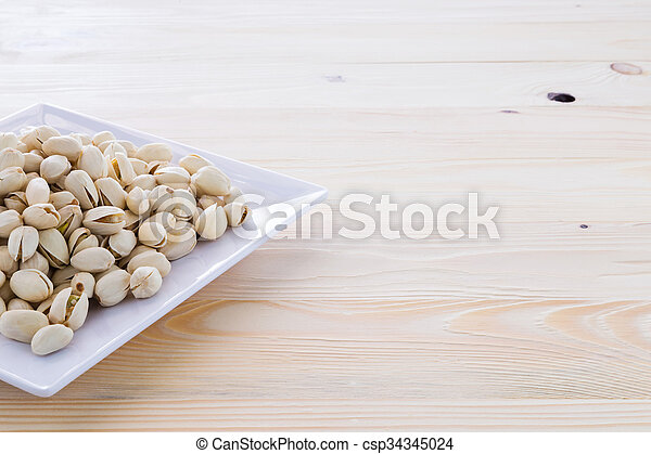 Pistachio nuts in a bowl - csp34345024