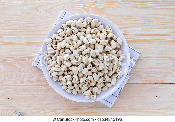 Pistachio nuts in a bowl - csp34345196