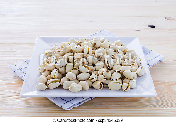 Pistachio nuts in a bowl - csp34345039
