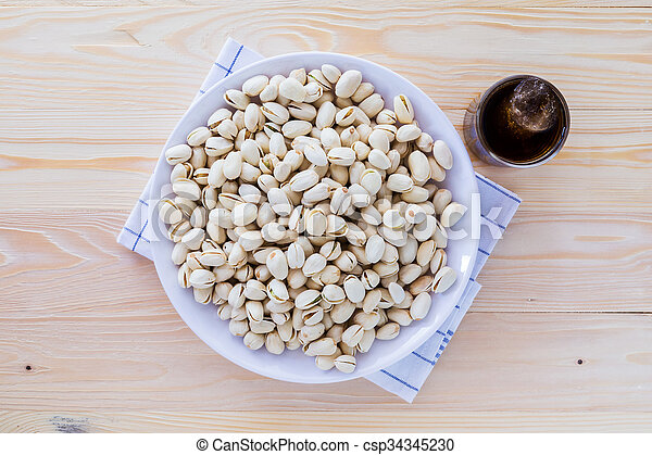 Pistachio nuts in a bowl - csp34345230