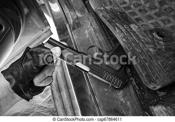Pistol in a car - csp67864611